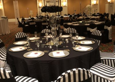 Church Banquet. Table Setup and Products (Linen, Chair Covers and sashes, chargers, centerpiece) by Epic.